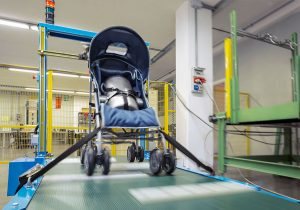 Baby stroller being tested for safety in a lab.