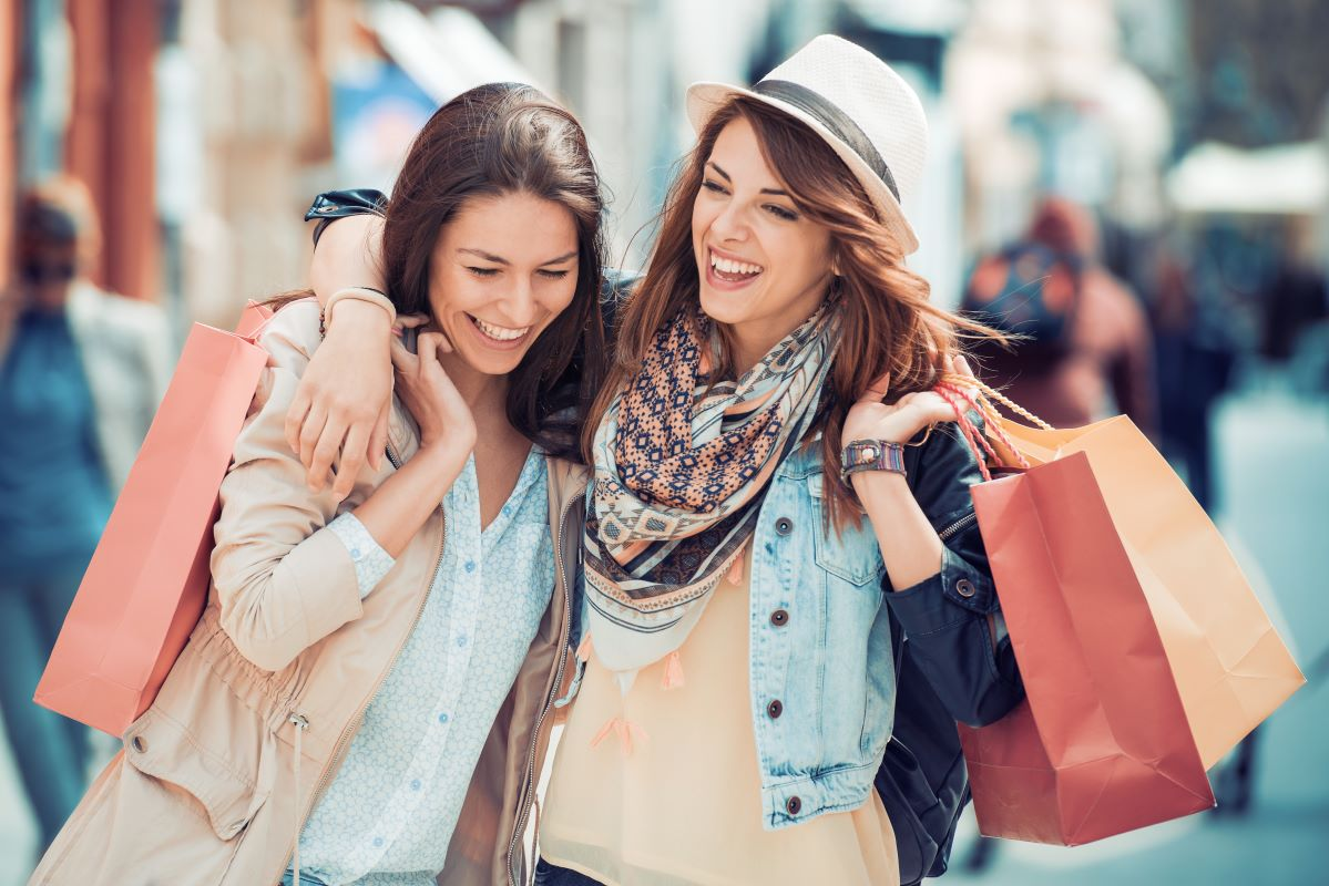 Two women shopping and laughing