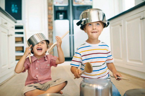 Children play safely with kitchenware