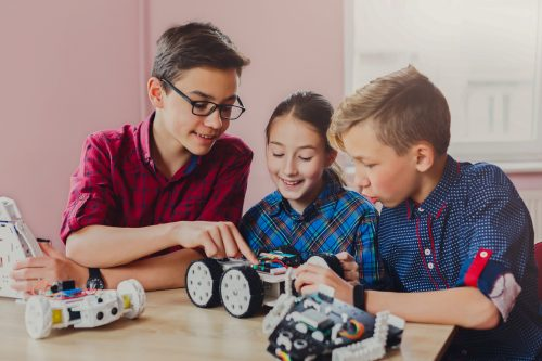 Children creating robots, stem education,