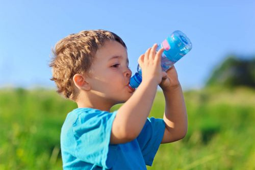 Little Boy Drinking Gas Water