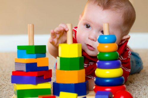bigstock Baby boy playing with stacking
