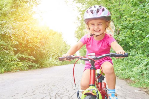 bigstock Happy Child Riding A Bike In O