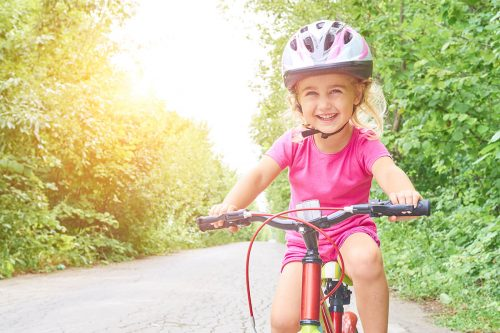 Happy Child Riding A Bike