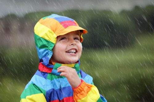 Little boy enjoying the rain